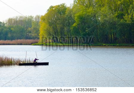 Fishing on the Tisza backwater in Hungary. The Tisza or Tisa is one of the main rivers of Central Europe. Forest green. Summer scene.