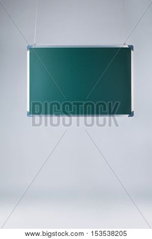 photo of green blackboard on bright background