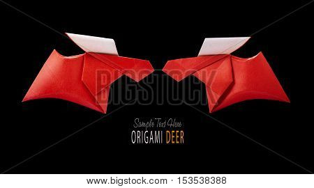 Origami paper red winter christmas running deer couple on a black background