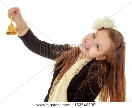 Joyful little long-haired girl with a white rose in her hair, rings the bell. Close-up.Isolated on white background.