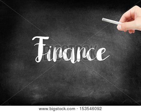 Finance written on a blackboard