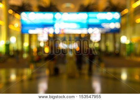 People at crowded place inside building, unfocused effect