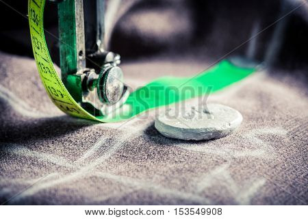 Old Sewing Machine With Scissors, Cloth And Threads