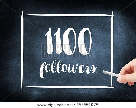 1100 followers written on a blackboard