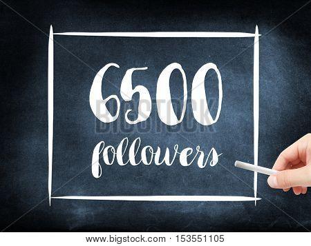 6500 followers written on a blackboard