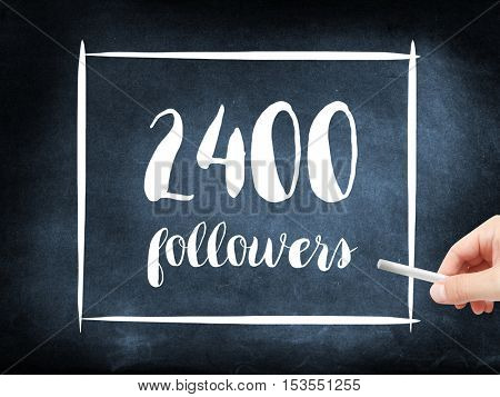 2400 followers written on a blackboard