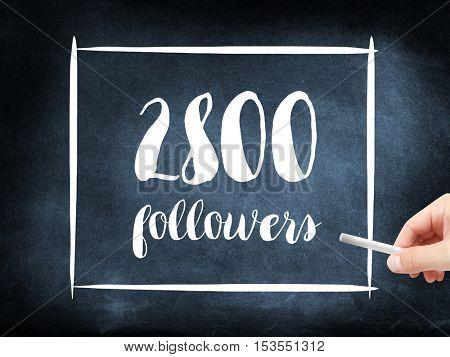 2800 followers written on a blackboard