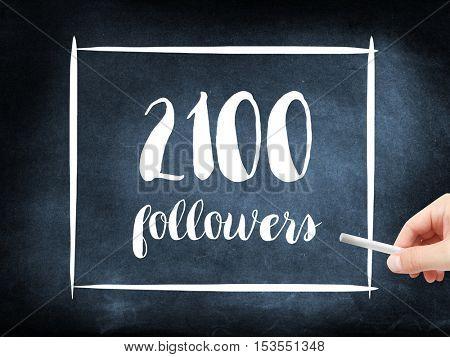 2100 followers written on a blackboard