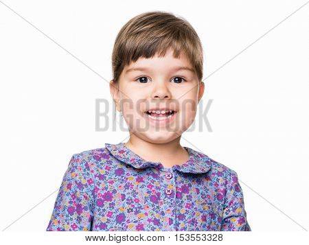 Emotional portrait of a 3 years old girl, happy. Cute caucasian baby isolated on white background. Beautiful preschool child posing in studio. Healthy carefree kid playing indoors.