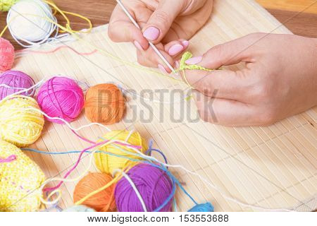 Colorful Clews Yarn And Female Hand Crocheting