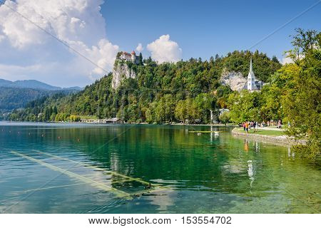 Bled, Slovenia - September 12, 2016: the castle of Bled and the picturesque lake Bled, a popular tourist destination.