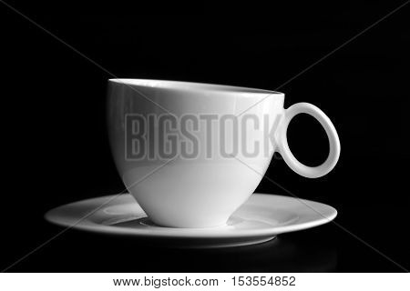 Cup of coffee on black background. Close up.