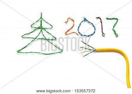 Christmas tree number 2017 made from cables of Twisted pair RJ45 and yellow patch cord for Lan network. Concept of New Year Christmas internet connection communication