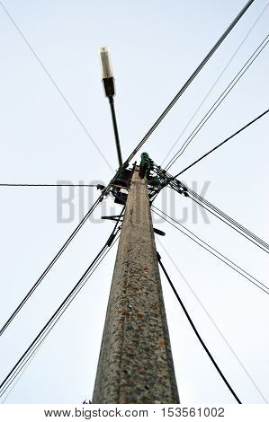 Electric pole with cables and street lighting