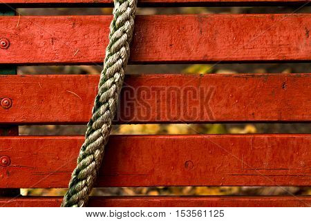 Rope On A Background Of Red Boards.