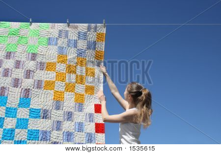 Girl And Bright Laundry