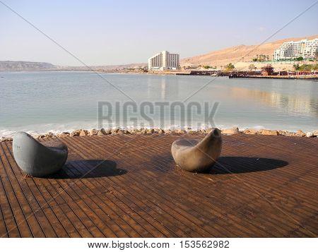 Chairs on the public beach of Ein Bokek Israel.