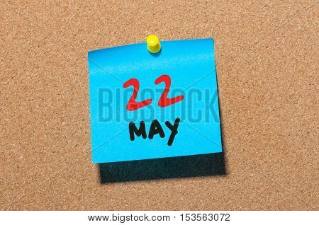 May 22nd. Day 22 of month, calendar on cork notice board, business background. Spring time, empty space for text.
