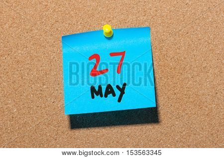 May 27th. Day 27 of month, calendar on cork notice board, business background. Spring time, empty space for text.