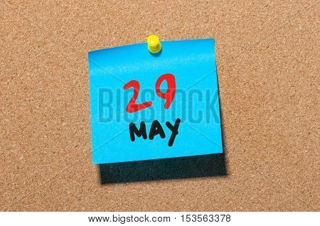 May 29th. Day 29 of month, calendar on cork notice board, business background. Spring time, empty space for text.