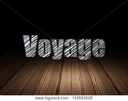 Travel concept: Glowing text Voyage in grunge dark room with Wooden Floor, black background