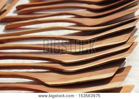 Handmade wooden pan blades at street market.