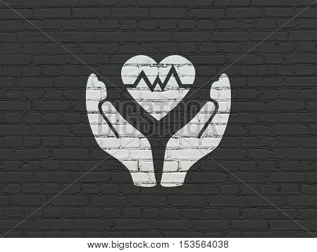 Insurance concept: Painted white Heart And Palm icon on Black Brick wall background
