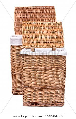 Natural wicker laundry basket isolated on white background