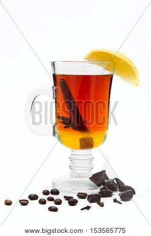 mulled wine in a glass of Irish with lemon cinnamon cumin decorated with coffee and chocolate