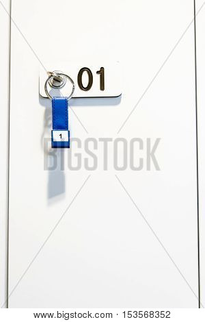 White locker whith a key and number one