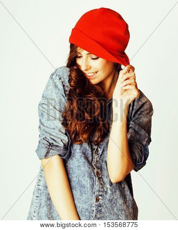 young cheerful brunette teenage girl on white background smiling