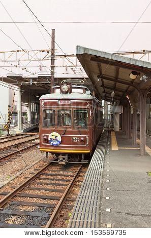 KYOTO JAPAN - JULY 28 2016: Retro-style tram of Randen Kitano Line at Katabiranotsuji Station in Kyoto. Operates by private Keifuku Electric Railroad