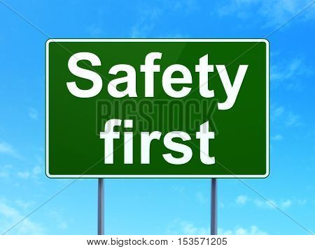 Security concept: Safety First on green road highway sign, clear blue sky background, 3D rendering