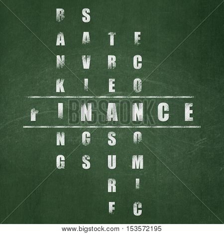 Banking concept: Painted White word Finance in solving Crossword Puzzle on School board background, School Board