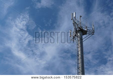 repeater telecommunication tower with blue sky on background