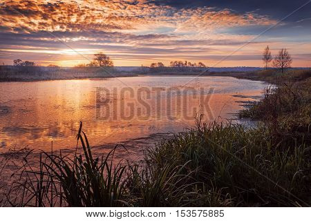autumn sunrise on the river in October day
