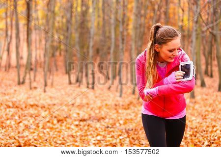 Sporty Girl Rest In Forest Listening Music.