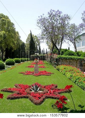 Akko Israel - May 11 2004: Flowerbeds in the form of stars in Bahai garden.