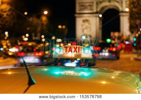 Neon Sign Of A Parisian Taxi
