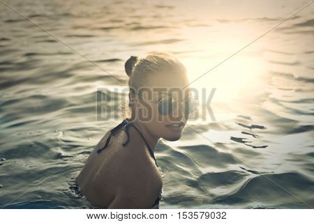 beautiful young woman at the sea