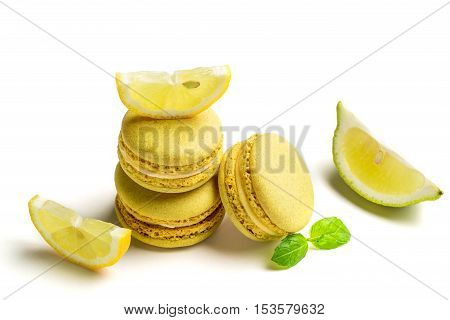 Tasty Macaroons With Lemon On White Background