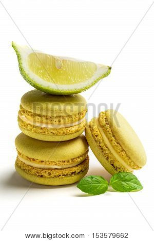 Fresh Macaroons With Lemon On White Background