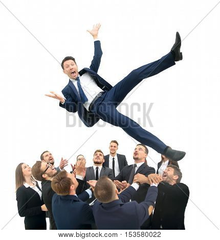 Business team throwing his colleague
