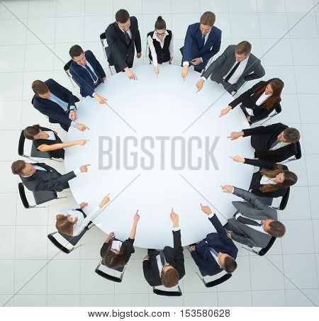 Top view of business team, sitting at a round table