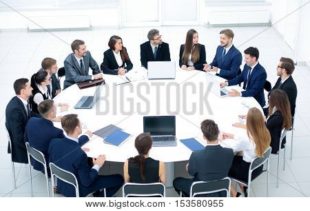 head of the company speaks to colleagues at conference