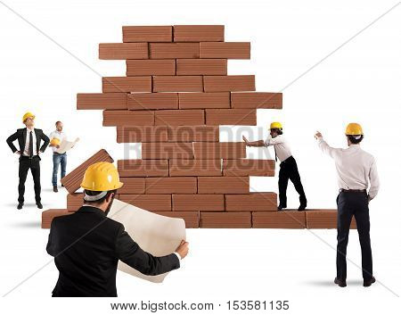 Team of architects working and analyzing on a bricks construction project