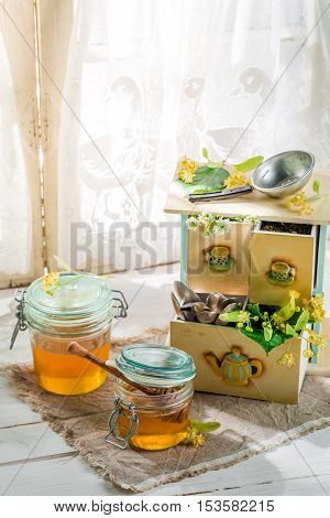 Healthy linden honey on old white table