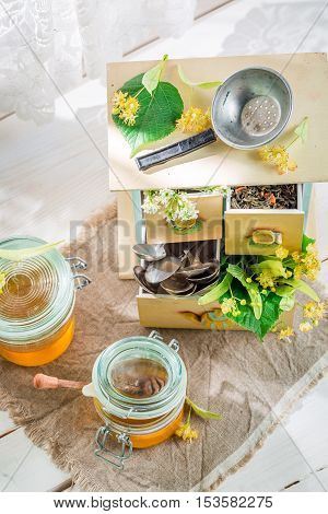 Fresh honey with linden on old white table