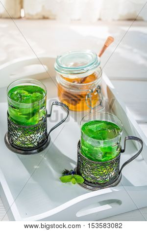 Fresh Mint Tea With Honey In Sunny Day