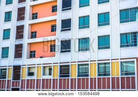 Colorful view of hotel building windows, pattern concept